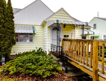 Cute and ready for a new family! Ramp can possibly stay or be relocated. Two story traditional, with two bedrooms on the main level a 3rd large bedroom in upper level with an abundance of storage, and a large cedar closet. Hardwood floors throughout under carpet , full bath on main level and a have bath on the lower level, partially finished lower level.  Coved ceilings and arched doorways, make for a certain charm.  All this and more near the rail trail! (photo 1)