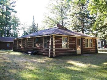 Waterfront up north living with Perma log exterior with log interior.  Low maintenance exterior!  This 2 bedroom and one bath,  open living room with a fireplace leading into spacious dinning room.  Clear Lake is a 171 acre all sports lake in Ogemaw County that is up to 50 feet deep.  Walking distance to town which has many conveniences such as a party store/diner and Clear Lake Bar and Grill.  Near 100's of acres of state land.  Golfing, hunting, hiking and shopping are all very close to this up north retreat. (photo 1)