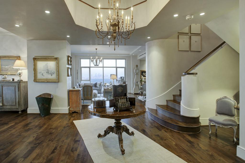 The spacious foyer offers a magnificent view of the Houston skyline. (photo 2)