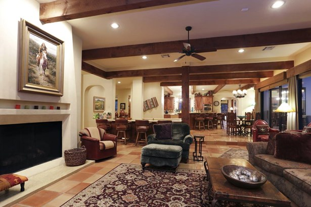 Inviting den with exposed wood beams and custom constructed fireplace. (photo 4)