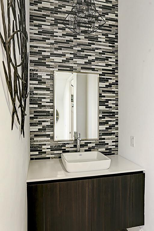 Here is an example of the upgrade wall in the powder room. (photo 5)