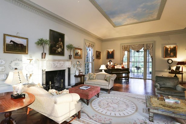 Large formal rooms are intimate and inviting. The living room s cove ceiling and central framed panel with trompe l oeil sky distract from it s daunting height. Note jib head windows that slide up to allow access to terraces. (photo 5)