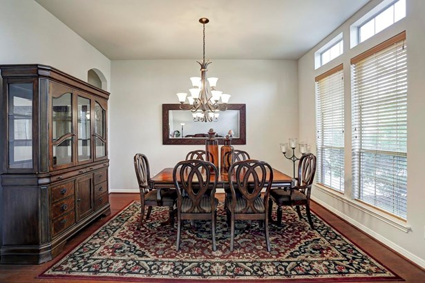 Formal dining room. Window treatments, chandelier and wood flooring. (photo 4)