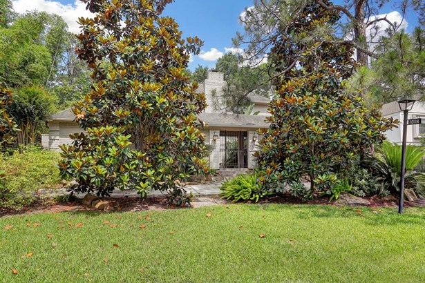 Lovely, updated, custom home on coveted and more rare wooded bayou lot in popular Briargrove Park. Set high on the lot, there have been no flood issues in this house, per sellers! Plenty of parking with the front circle drive. (photo 1)
