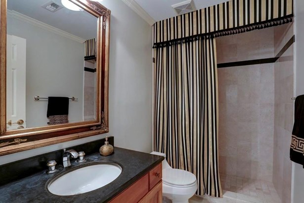 In the hallway just off of the foyer is this full bath which also serves as a guest powder bath. It features marble topped vanity as well as a marble shower. It could also serve as a guest bath for the potential downstairs guest room. (photo 5)