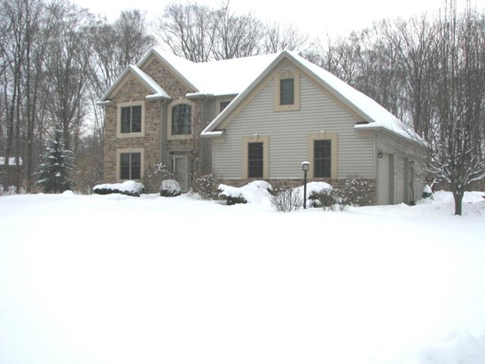 Over 3400 sq ft, 5 bedrooms , first floor master,office,wonderfull eat in kitchen with breakfast bar,4+ private wooded acres,extra garage,incredible,pristine home.  (photo 1)
