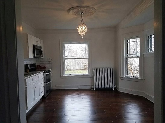 Stunning hand-scraped flooring, lovely chandelier, updated appliances, eat-in area (photo 3)