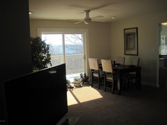 Dining area at end of living room; sliding doors to deck and view (photo 5)