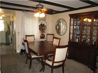 Dining Room with beam ceiling and ceiling fan (photo 5)