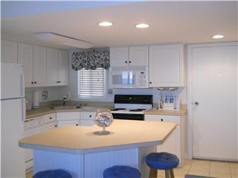 Light, open kitchen with storage island (photo 3)