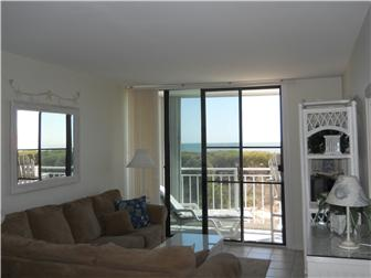 Living room with ocean views is open to kitchen (photo 5)