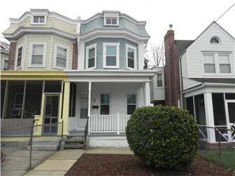 Front porch, beautiful white brick home (photo 1)