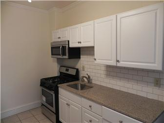 Gas range and built in microwave  (photo 5)