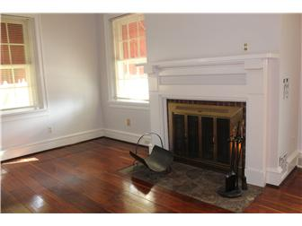 Living Room fireplace with stone hearth (photo 2)