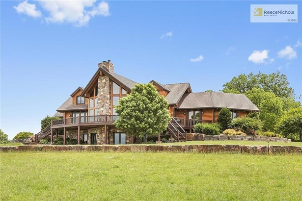 Beautiful and unique property sitting on one of the highest points in Miami County.  Remarkable 8500+ sq.ft. Douglas Fir custom built log home with 5 bedrooms / 6.2 baths and an attached studio apartment. (photo 3)