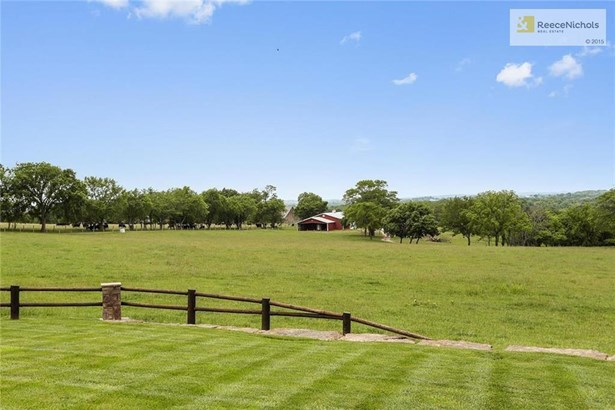 Beautiful view of the countryside and private lake from the back deck. (photo 5)