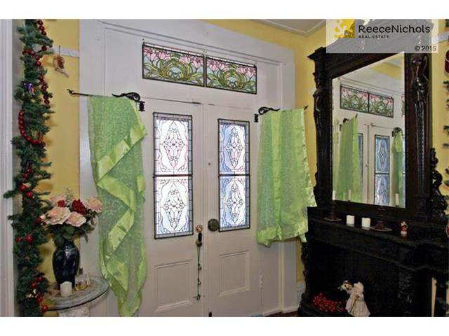 Beveled glass front doors with stained glass transom. Original hardware and doorbell. (photo 4)