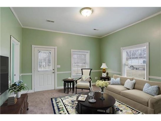 Notice the new carpeting and virtual staging to give you an idea of how to decorate. (photo 4)