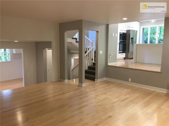 Spacious Family Room with Inviting Fireplace and Beautiful new Hardwood Floors~This Room Opens to the Kitchen~ (photo 5)
