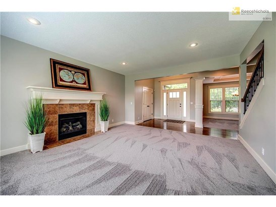 Family room with recessed lighting and gas fire with craftsman mantel and surround (photo 4)