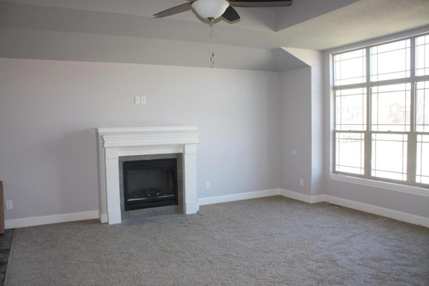 Great room with fireplace (photo 2)