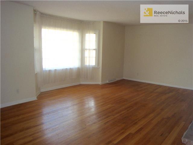 Living room with hardwoods and bay window. (photo 2)