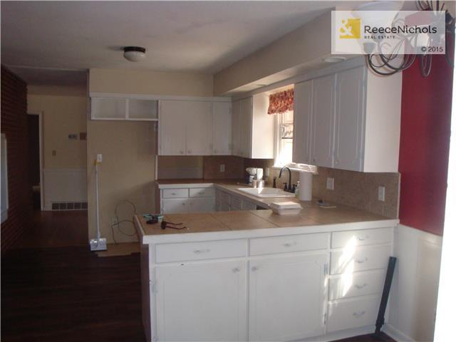 Kitchen with tile countertops (photo 4)