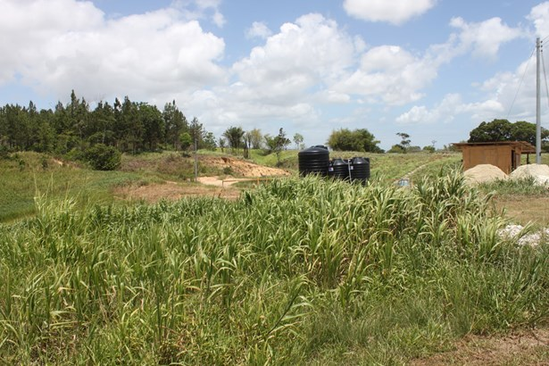 Beautifully landscaped 57,845 square feet parcel of land for sale. (photo 3)