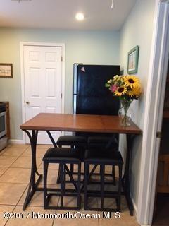 Condominium,Condominium - Attached,End Unit,Lower Level,One Level Unit (photo 1)
