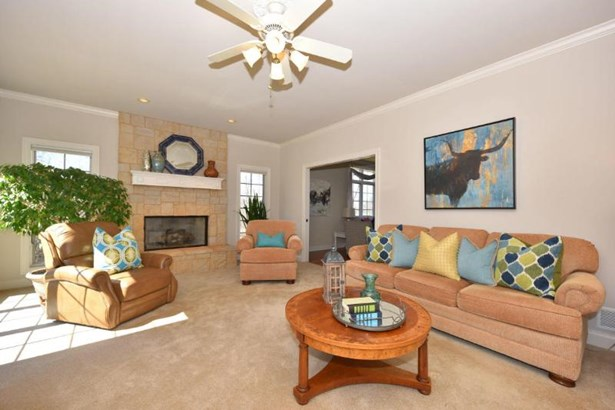 Large family room w/ gas fireplace (photo 5)