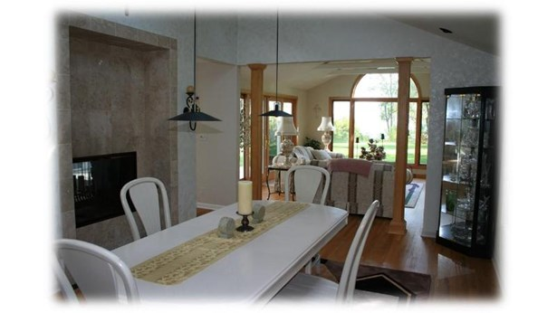 Formal Dining Room with 2-Way Fireplace (photo 4)