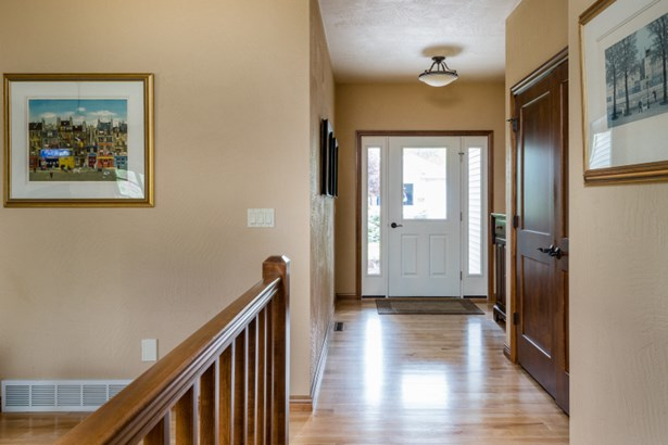 Foyer Entrance w/ Hardwood Floors (photo 2)
