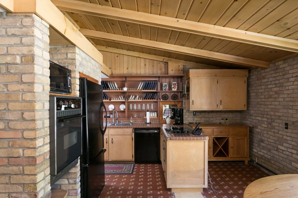Kitchen w/ Appliances & Brick Accent (photo 4)