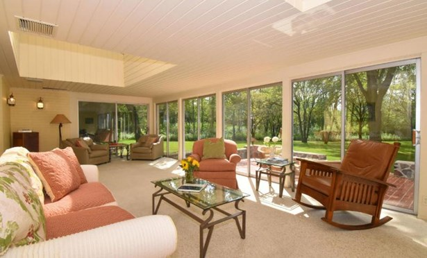 Sunroom with View of Private Backyard (photo 3)