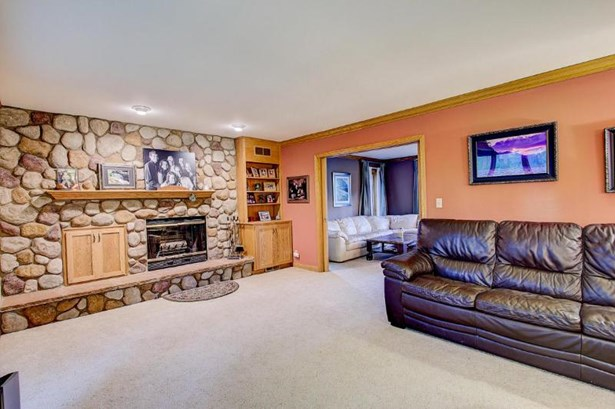 Family Room with Natural Fireplace (photo 4)