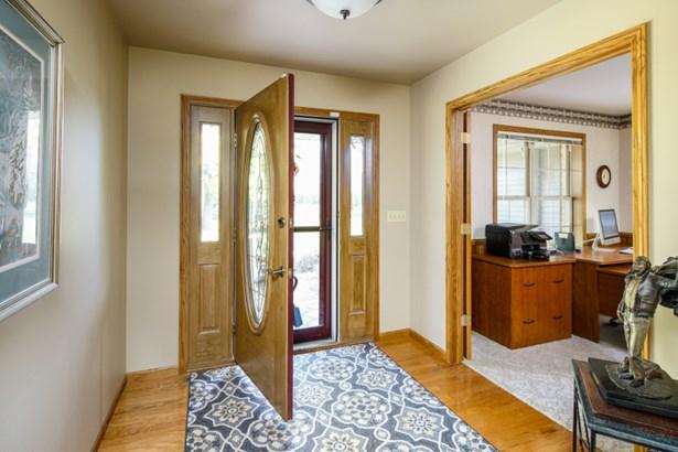 Inviting Foyer w/ Hardwood Floors (photo 2)