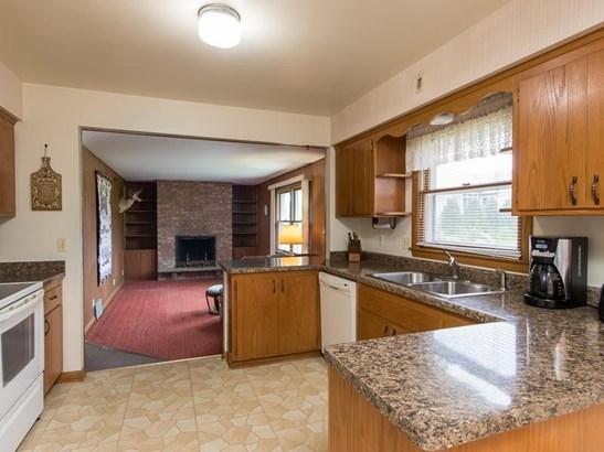 Kitchen view to den (photo 3)