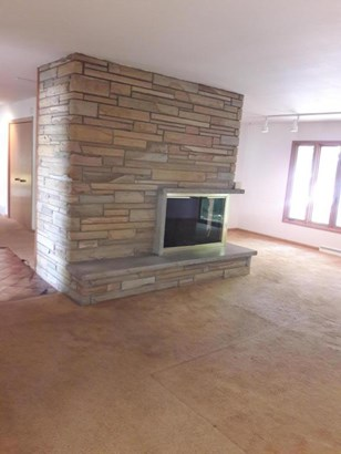 Family Room with Double Sided Fireplace (photo 4)