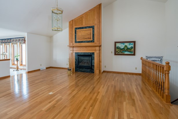 Great Room w/ Fireplace & Wood Floors (photo 3)