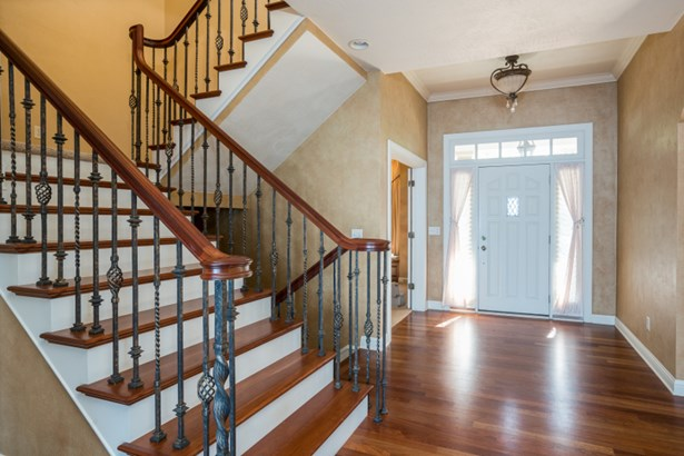 Inviting Foyer & Gorgeous Open Staircase (photo 2)