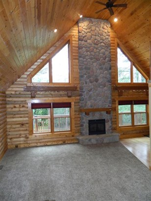 Floor to ceiling stone firepla (photo 4)