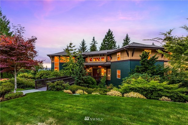 Custom luxury view residence built in 2003 exudes North West modern elegance in this two-story with walk-out basement on .65 professionally landscaped lot at the top of the view loop in desirable Licorice Fern