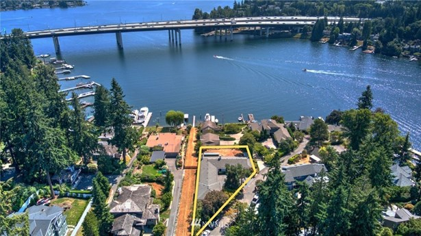 WATERFRONT VIEW IN BELLEVUE!!  Only one well-established compound sits between you and the water and it is located pleasingly below this Property so your view from this Property is amazing((The long strip of land to the East of the Subject Property here to the left of the outlined Subject Property), is privately owned by a neighbor living to the North of Enatai Drive.  It is NOT public access to the waterfront nor access for the Subject Property)