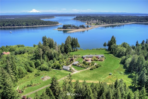 Stunning 31 acre waterfront estate offers views of Mt. Rainier, Totten Inlet, Steamboat Island, Hope Island and beyond.