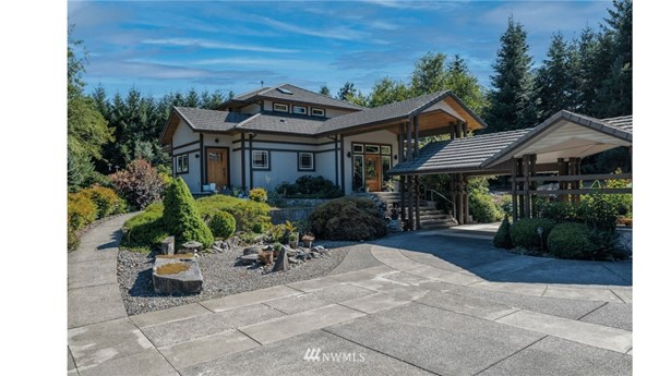 This is a must see!! This 7.5 acre, 5200 sf home is stunning and built with the finest materials made. Enjoy your own private gardens relaxing on the outside patio and decks.