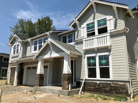 This photo has been taken from a Rainier plan 4245 sf  (Elevation B) of a different home at Clyde Estates. Exterior paint color scheme will be different than the home in this photo. Color, Design, Finishes are subject to change.