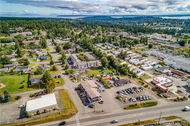 Building is at 6 o'clock and sits on 4 lots, .62 acres.