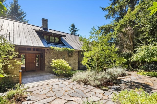 Beautiful entry courtyard is serene and quiet with easy-care, mature landscaping.