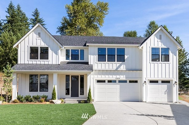 Rainier - 4245 SF plan on lot 10 is a PRESALE with a end of April - May completion.  Great time to pick your interior color scheme package! The home in the photo is sold and an example of the Elevation for the Rainier on lot 10.  The exterior paint color, design, details and finishes are subject to change.