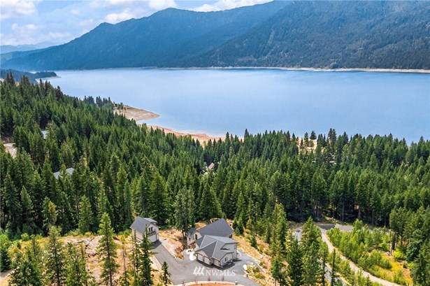 Paved community maintained road leads to this spectacular lake view mountain retreat.